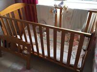 BabiesRUs pine cotbed with Humphrey's Corner nursery set.