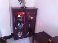 mahogany effect display cabinet with glass doors and 2 internal glass shelves.
