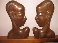 Man and woman carved woo sculpture