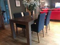 Walnut coloured dinning table & 4 grey chairs, table extends to seat 8. Excellent condition