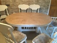 Chalked kitchen extending table and 6 cream crushed velvet chairs.