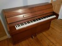 Small modern upright piano CAMDENPIANORESCUE can deliver