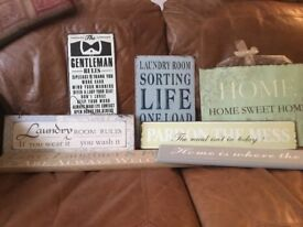 Selection of metal and wooden wall plaques