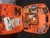 Paslode IM65 nail gun complete in box c/w batteries and charger