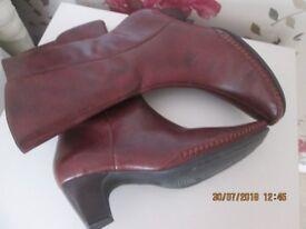 ladies brown boots with heel.