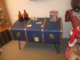 vintage travel case / trunk made into a coffee table with hairpin legs.