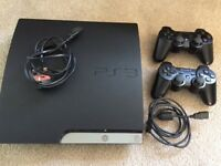PS3, 2 x controllers and 8 x games