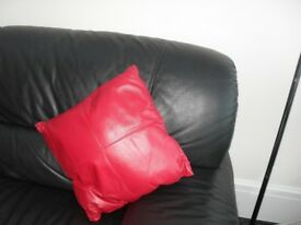 2 Real leather red cushions in perfect condition.