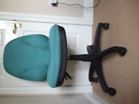Green office chair on Castors