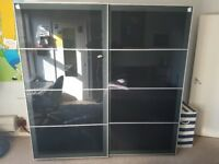 Ikea PAX Wardrobe with black glass UGGDAL sliding doors, good condition, selling due to move