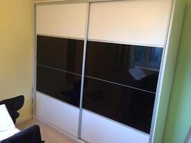 Double wardrobe with sliding doors