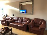 Tan leather sofa plus 2 arm chairs. Sofa cushions showing some wear and tear