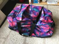 Large hold-all sports bag luggage wheelie suitcase in pink and purple