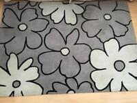 Brown and ivory floral rug