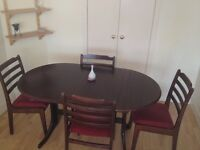Solid Wood Good Condition Dinning Table With 4 Chairs to Sell