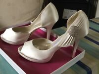 Brides brand new Rainbow Couture Shoes