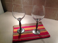Two tall metal based wine glasses made in Thailand