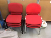 12 red office chairs stackable good condition
