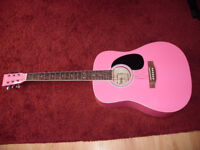 Full size bright pink acoustic guitar excellent condition £35ono