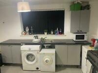 Kitchen units and worktop sink and taps