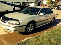 2003 Chevrolet Impala includes set of winter tires with rims!!