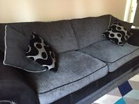 4 seater black and grey fabric sofa and round love chair and footstool including cushions