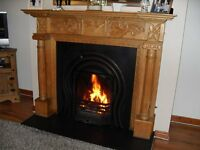 Fireplace metal with wooden surround