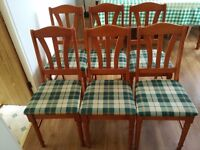Six pine dining chairs with fabric seats