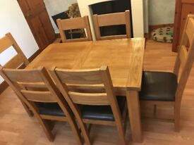 Solid oak extendable table &6 chairs & matching cabinet available
