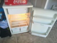 Under counter fridge with freezer compartment. Perfect working order, minor scratches on door