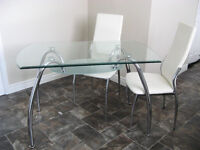 Glass topped dining table and four chairs.