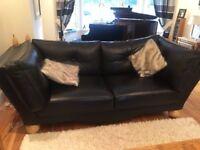 Ebony black leather sofas stunningly stylish pristine condition. One Left