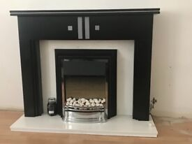 Fireplace with dimplex heater