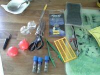 worm scissors, styl pliers, baiting needle, 4 bubble floats, 2 whiteglow false corn, slip shot