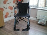 Travelite wheel chair only used 3 times.