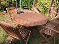 Wooden garden hexagon table and folding wooden chairs