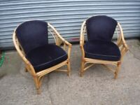 Pair of Bamboo Arm chairs , with seat and back cushions.