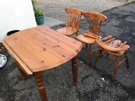Solid Pine table and four chairs two needing repair