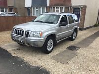 Silver Jeep Grand Cherokee in good condition for year
