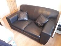 Two seater leather Sofa with two pillows in black