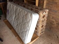 Single bed , base with mattress .