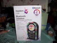 FREEDOM BY INTEK BLUETOOTH JUKEBOX WITH C.D. PLAYER FM RADIO