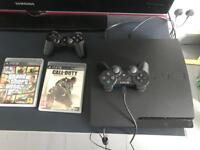 Slim Sony PS3 + 2 controllers + 2 games