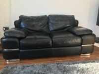 Black leather sofa two-seater