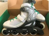 Women's size 8 'No Fear' inline skates with unisex large guard set included. Brand new, never worn.