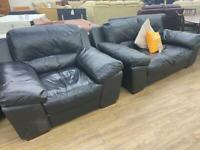 Black leather two seater sofa and large armchair