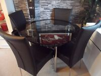 Harvey's Black glass boat table and 4 black chairs