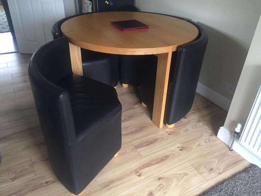 Oak Effect Round Table With 4 Leather Look Hideaway Chairs