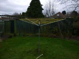 Rotary clothes dryer and ground socket, used