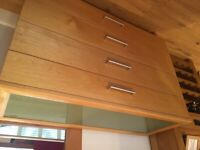 Glass top chest of drawers